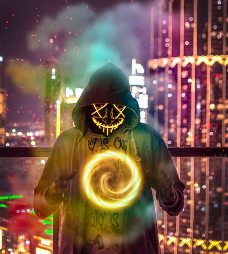 man wearing hoodie forming chakra wallpaper